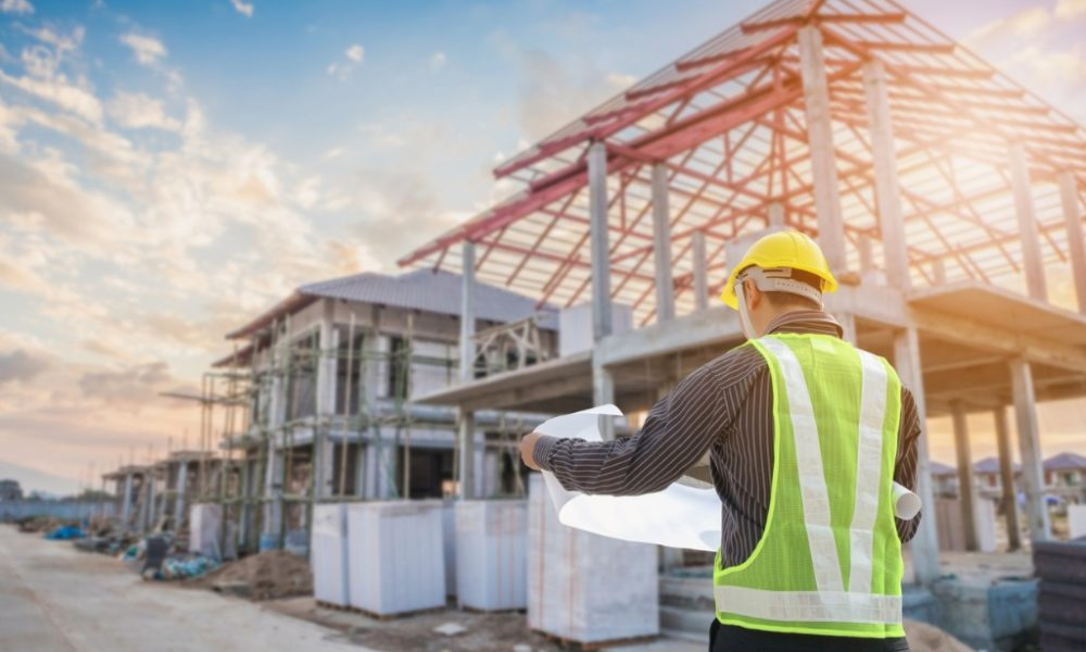 professional-engineer-architect-worker-with-protective-helmet-and-picture-id1041465228